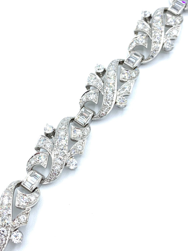 A stunning Art Deco Diamond and platinum bracelet.  The mix of round cuts and baguette Diamonds make this bracelet gleam with light!  The Diamonds have a total weight of 8.68 carats, and are graded as G-H color, VS clarity.  The bracelet features a
