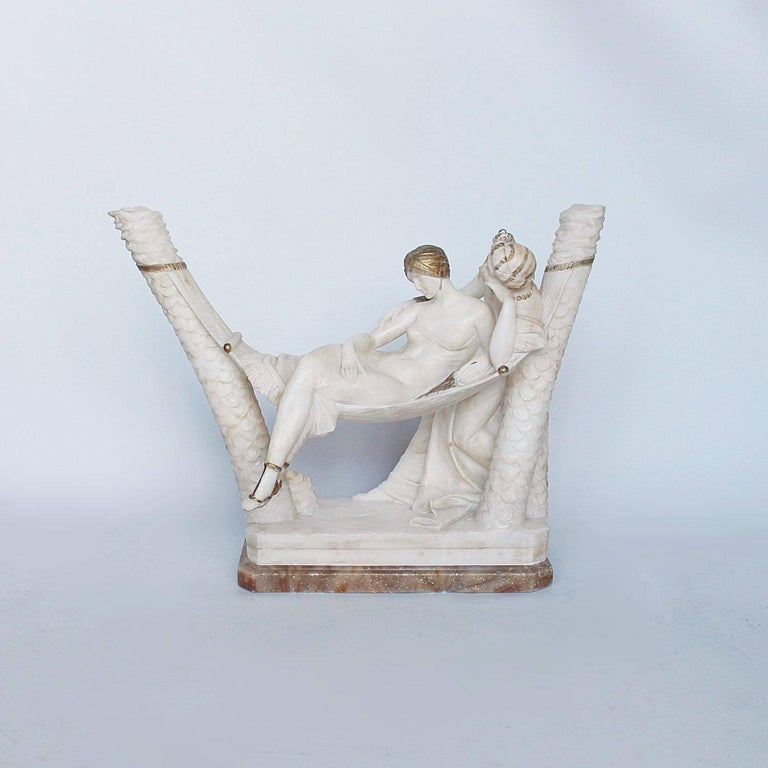 The lovers, a sculpture of a couple in daydreaming pose in alabaster with gilding.  Emilio P. Fiaschi studied at the Accademia di belle Arti in Florence from 1883-1885. He followed in the tradition of Florentine sculptors of Carrara marble, and is