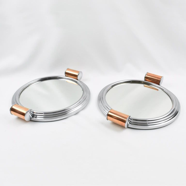 Modernist French Art Deco cocktail serving tray. We have two similar pieces that can be sold as a set or individually. Machine Age industrial design with polished aluminum metal round stepped framing, mirror insert, and round copper