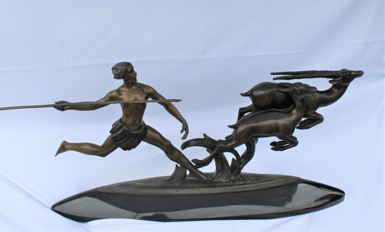 A great super action sculpture of a male hunter after two gazels. Has a signature on the base of Ketley. A great big piece of absolute marble base. The spear is removable for shipping. Very heavy. Would look good on a large mantel. Or a center piece
