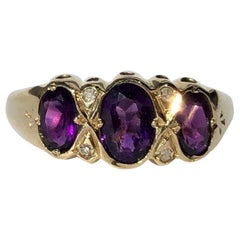Art Deco Amethyst and Diamond 9 Carat Gold Three-Stone Ring