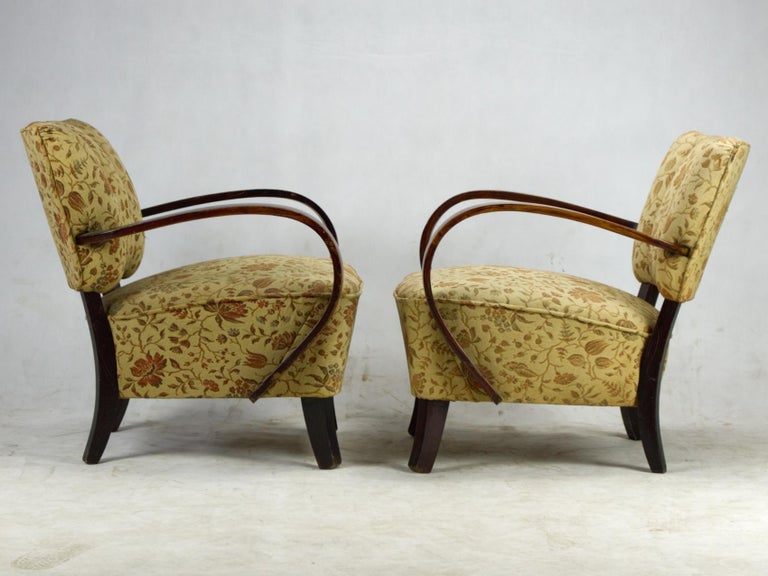 These armchairs, model H 237 were designed by Jindrich Halabala and produced in Czechoslovakia in the 1930s by UP Zavody Brno. The chairs are in vintage condition and the springs and wood are very stable.