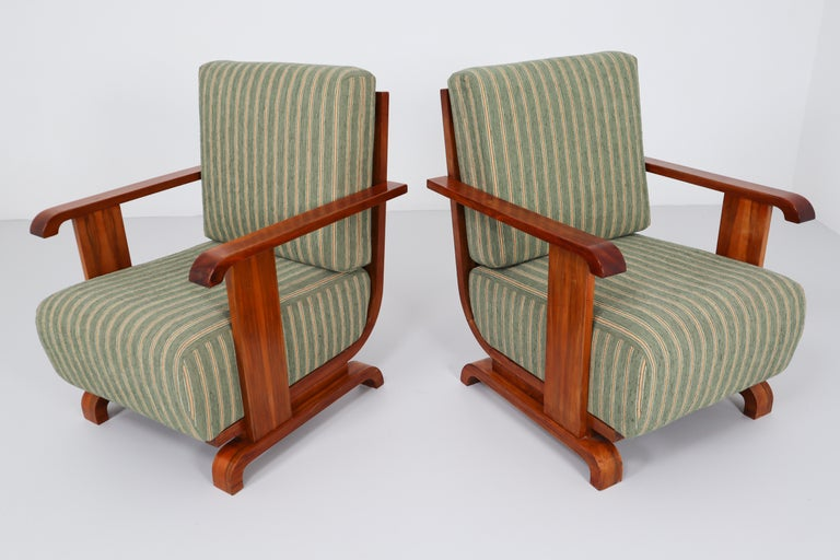 A pair of Art Deco Austrian armchairs from Vienna, reupholstered in a new olive green velvet blend. The frame and arms are made of a beautiful walnut. We couldn't resist the comfort and impeccable lines of these.