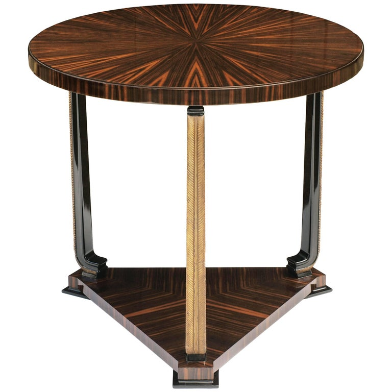 An exceptional ebony Macassar and parcel-gilt circular table by Axel Einar Hjorth for Nordiska Kompaniet, circa 1928.