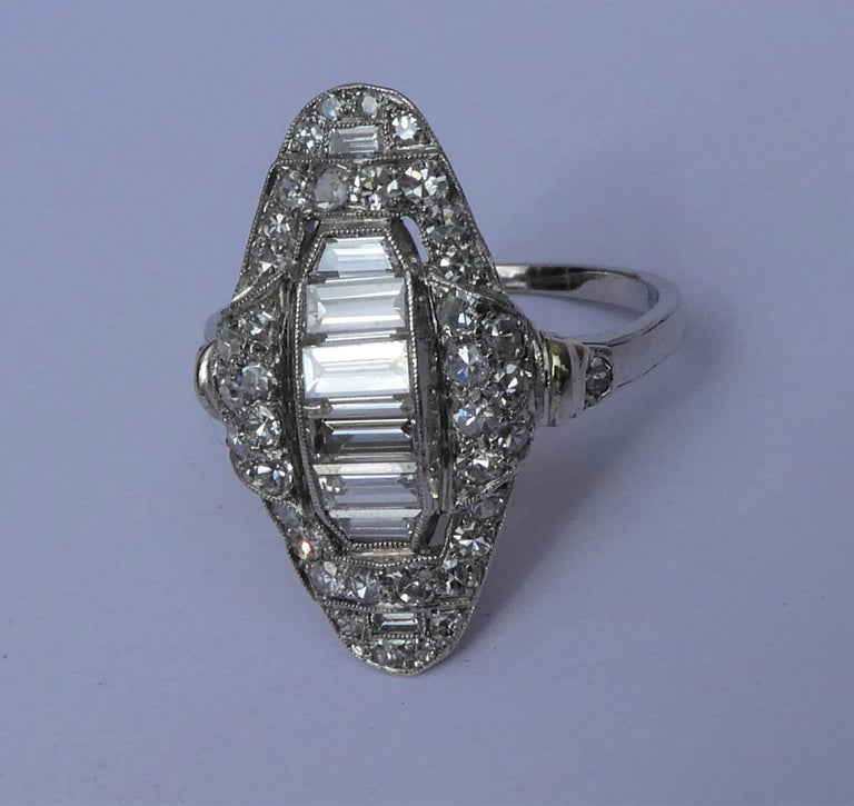 Art Deco Baguette and Round Diamond Platinum Cluster Ring In Excellent Condition For Sale In Munich, DE