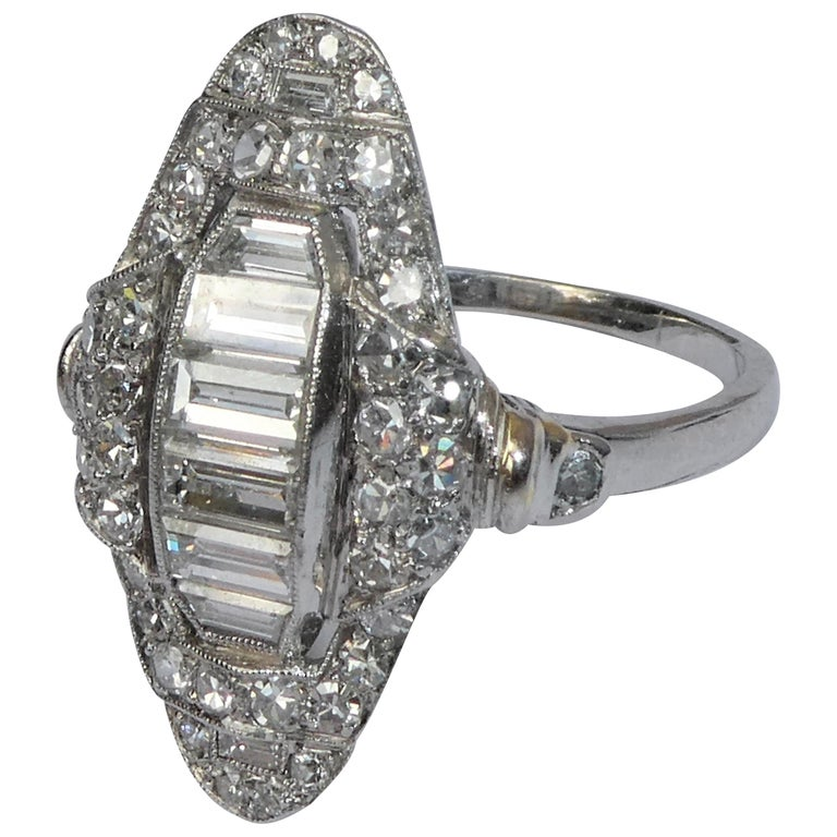 Art Deco Baguette and Round Diamond Platinum Cluster Ring For Sale
