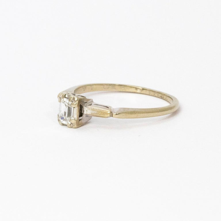 Sparkling baguette diamond set in 14ct gold with beautifully detailed setting.  Ring Size: P or 7 3/4