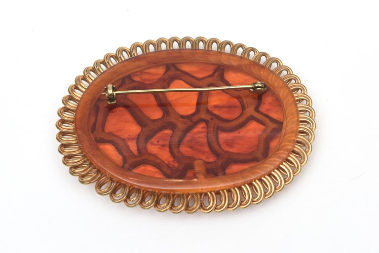 Art Deco Bakelite and Brass Carved Oval Pin Brooch For Sale 3