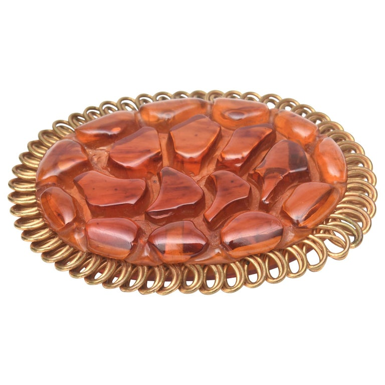 Art Deco Bakelite and Brass Carved Oval Pin Brooch For Sale