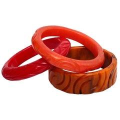 Art Deco Bakelite Carved Bangle Red, Amber, Orange Bracelets Set of Three