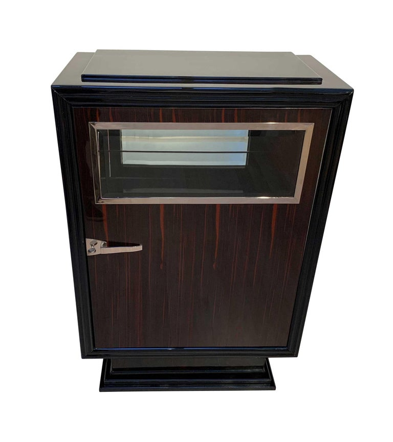Wonderful original and greatly refinished Art Deco Bar Furniture / Small Cabinet in Macassar from France, circa 1930  Macassar ebony wood veneered and high-gloss lacquered corpus. Ebonized / black lacquered frame, leg and top plate.  Original, newly