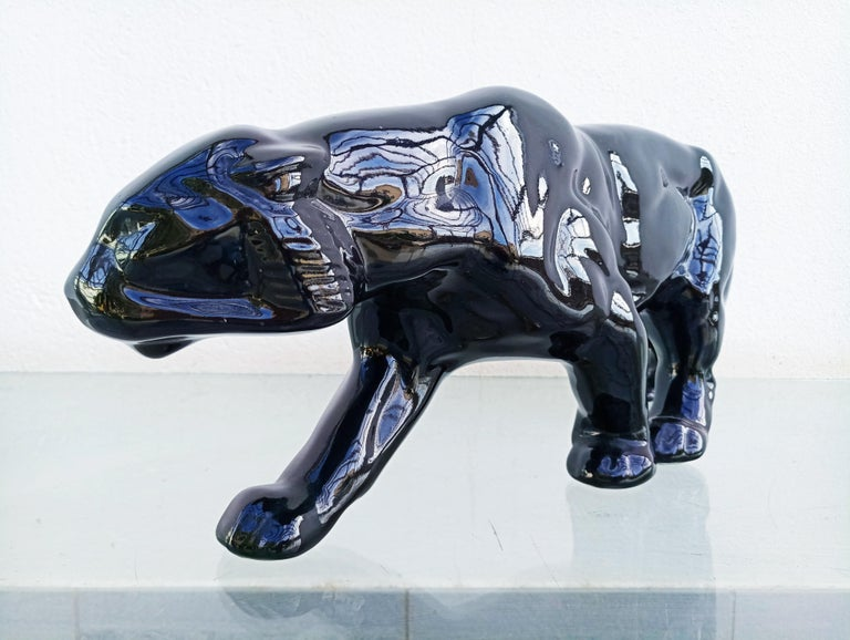 Beautiful French art deco panther ceramic manufactured in 1930s.This panther has been made in black, green and red. This is the black one! Same period as Charles Lemanceau, François Pompon, Lejean, Jean & Jacques Adnet, Geo Conde, Charles Catteau,