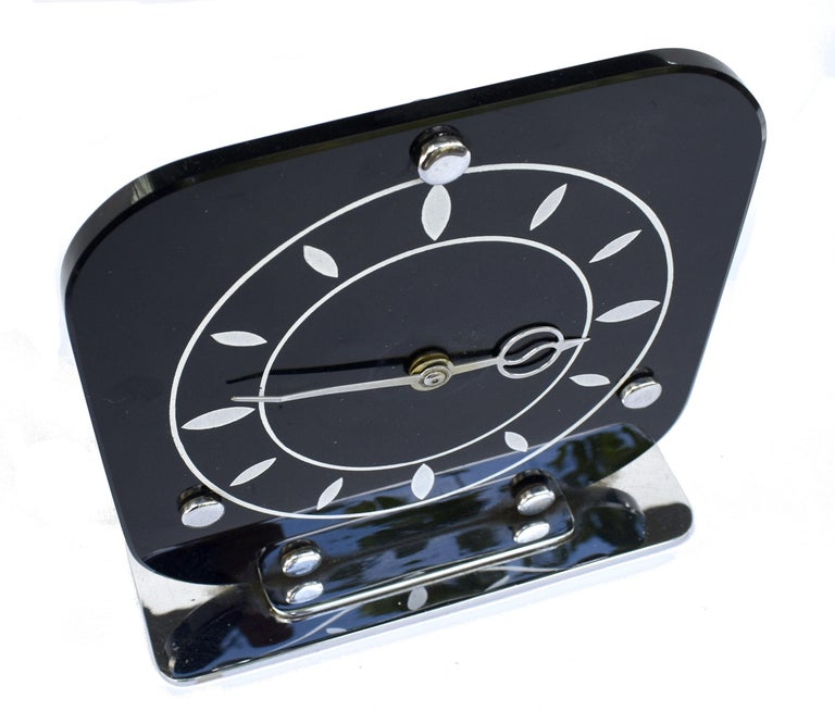 For your consideration is this fabulous 1930's Art Deco English Mantle clock with a superb modernist feel. Jet black vitrolite ( compressed glass ) more often used in Deco bathrooms for splash backs or panelling if you have ever seen those, which