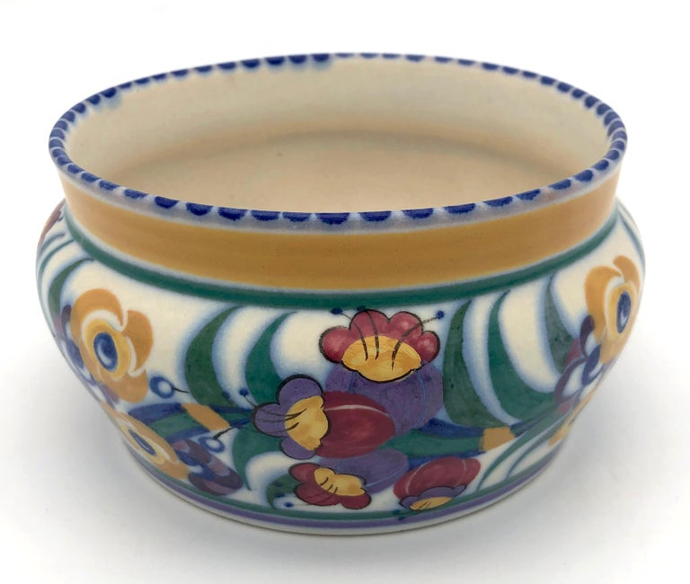 This charming piece of Art Deco studio pottery was hand crafted and brush painted in the second half of the 1920's. The early decorative ceramics were made from red earthenware and have red unglazed bases,. These red bodied pieces are considered