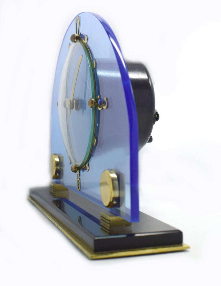Original 1930s blue perspex clock by the English clock makers Smiths. Beautiful blue dial face which sits of a jet black perspex plinth with brass numerals and accents. Fabulous condition, full working order. (We can provide a power adaptor so the