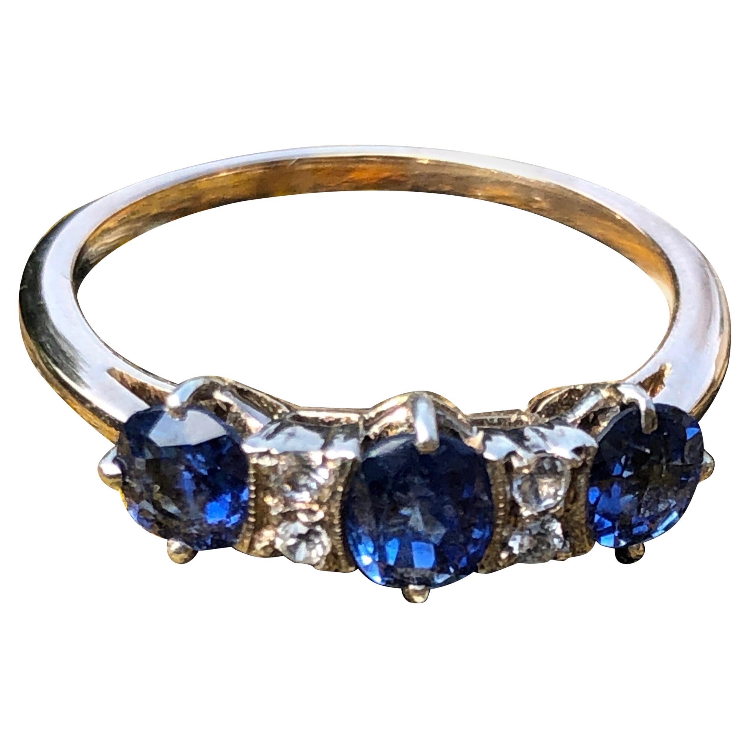 Art Deco Blue Sapphire and White Sapphire 9 Carat Gold Three-Stone Ring