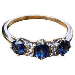 Art Deco Blue Sapphire and White Sapphire 9 Carat Gold Three-Stone Ring