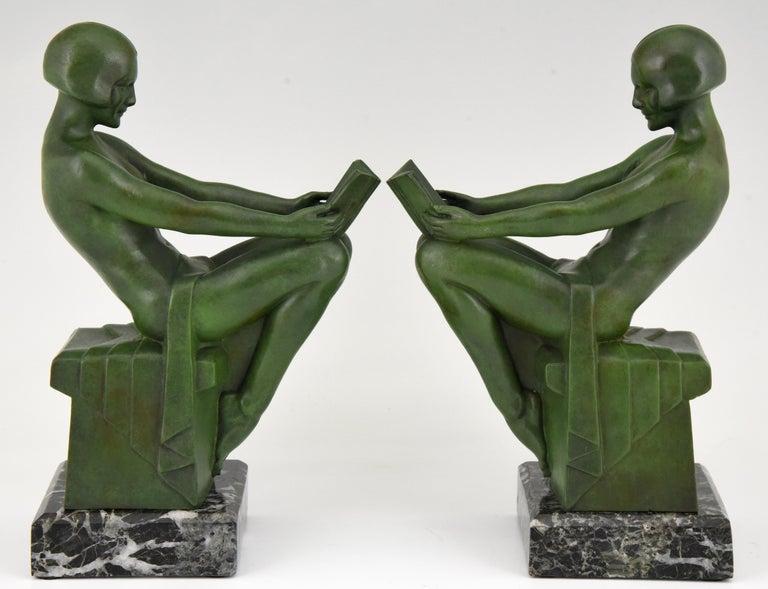 Patinated Art Deco Bookends Reading Nudes Delassement Max Le Verrier, France, 1930