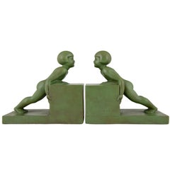 Art Deco Bookends with Children Signed Janle, France, 1930