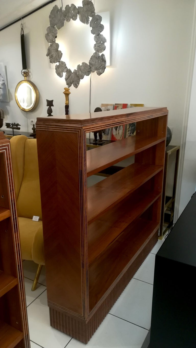 Art Deco bookshelf, circa 1930 One fix shelf in the middle and two shelves adjustable. (We have a pair available).