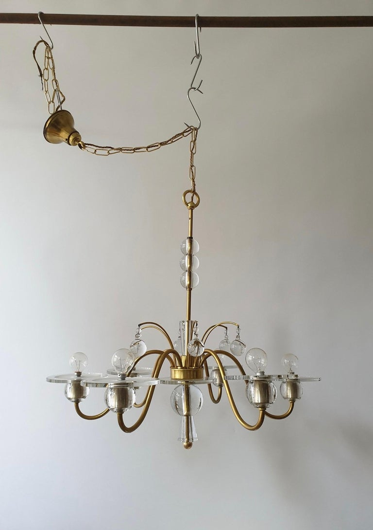 Art Deco glass and brass chandelier. Measures: Diameter 70 cm. Height fixture 67 cm. Total height including the chain 130 cm.
