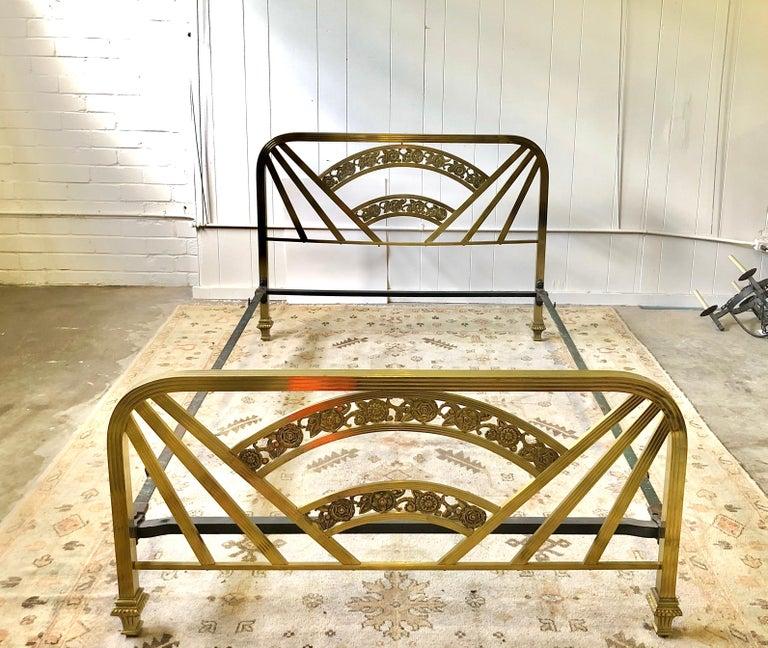 Early 20th century Art Deco full size bed frame with decorative headboard and footboard of brass and including the original side rails. The frame measures: 53.5