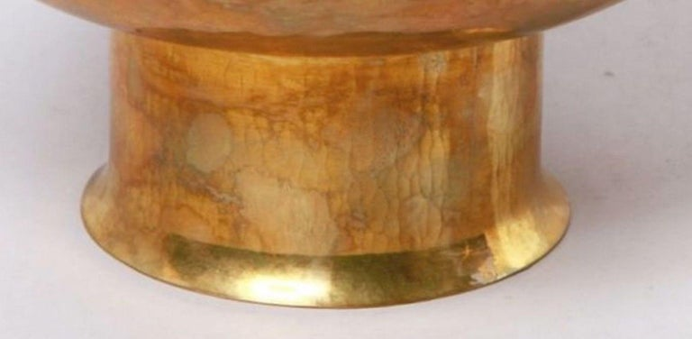 Art Deco brass serving plate is an original decorative object realized in the first years of the 20th century.  Original brass.  Made in Germany. The   Mint conditions.  Art Deco brass plate with a cilindrical body probably realized in