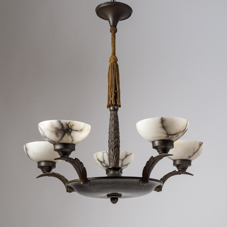 Superb five-arm Art Deco chandelier from the early 20th century. Dark patinated bronze hardware with abstracted palm tree ornaments - the central stem has the shape of a palm tree trunk while the arms are worked as stylized palm leaves. Each arm has
