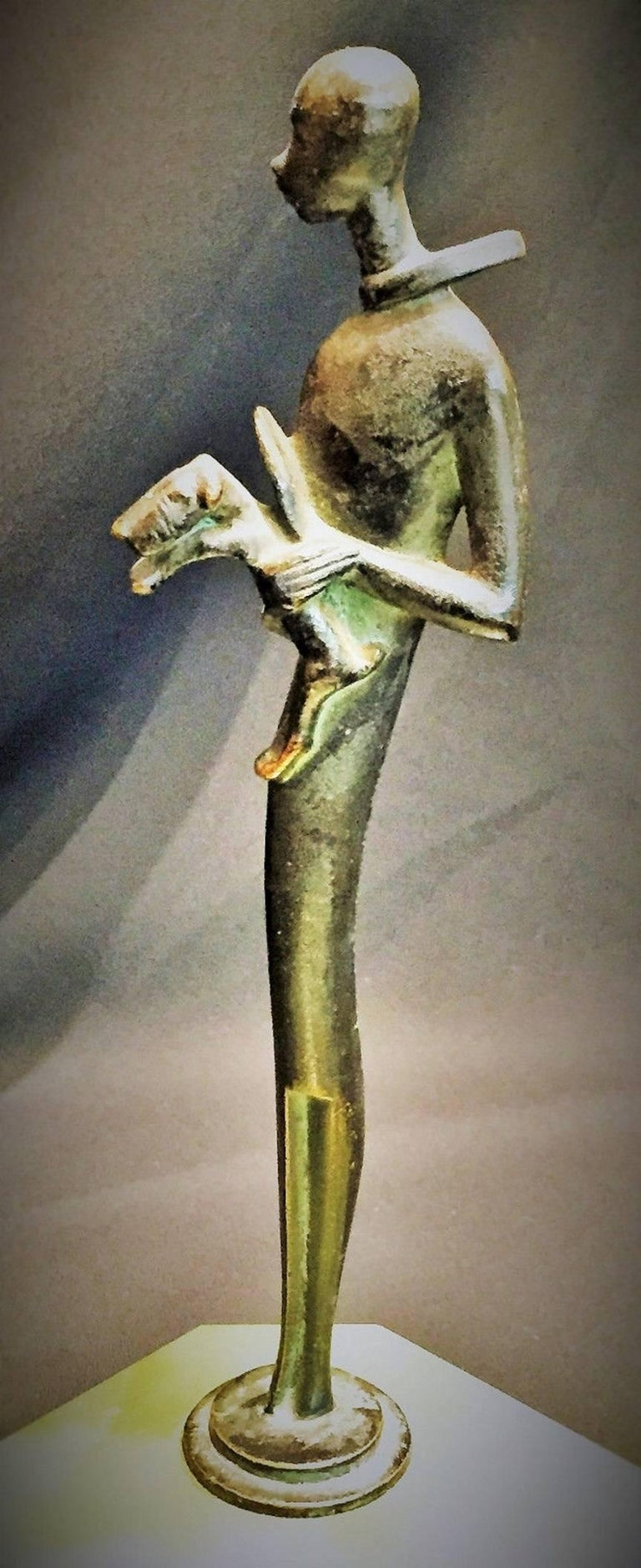 Unmarked, probably Austrian, this charming carved green agate octagonal ashtray with green/black patinated bronze handle is done in the manner of Hagenauer - a superbly detailed and stylized slender tall man, wearing a scarf waving in the wind, and