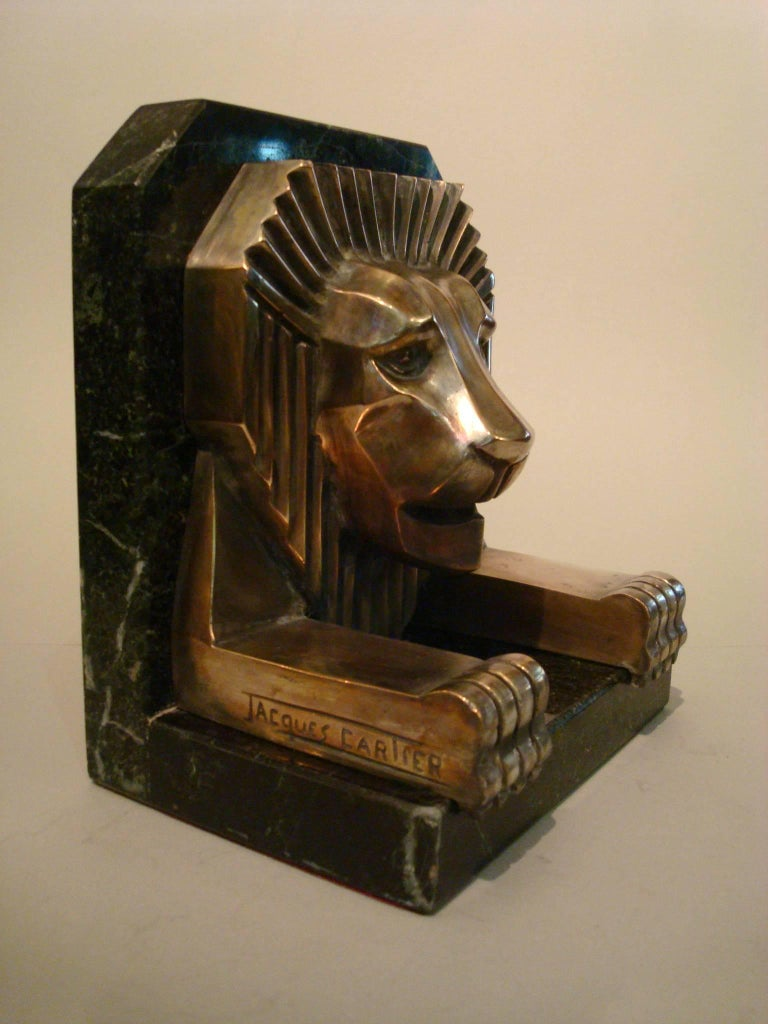 Fantastic Art Deco bronze lion bookends. Silvered plated. Dark green marble. Signed Jacques Cartier, France, 1925.