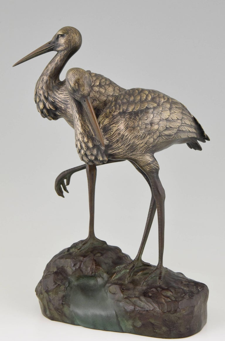 A bronze sculpture of a couple of storks by A. Vannier, 1930. 