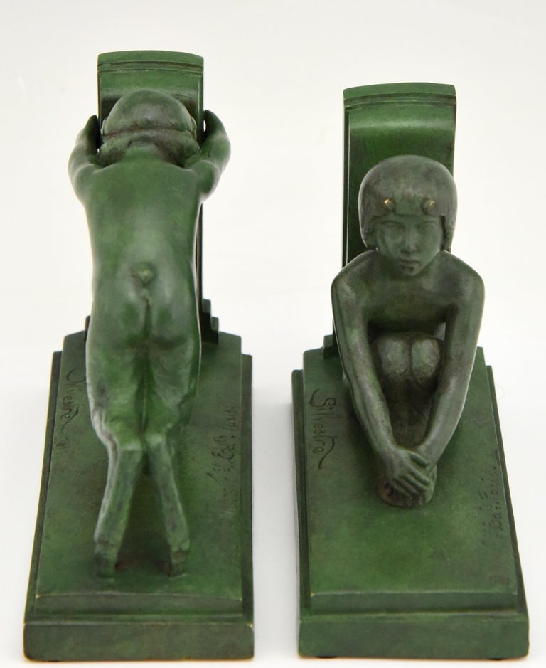 Patinated Art Deco Bronze Bookends Boy and Girl Satyr Paul Silvestre, France, 1920