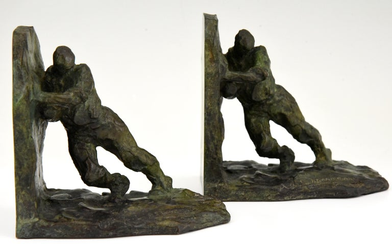 Early 20th Century Art Deco Bronze Bookends Two Men Pushing Victor Demanet 1925 France