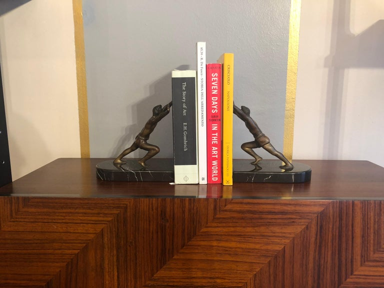 Art Deco bronze book holders with marble bases. Very detailed and finely made little bronze sculptures. Size of each: High 13 cm wide 15 cm deep 10 cm Ideal as Christmas or wedding present.
