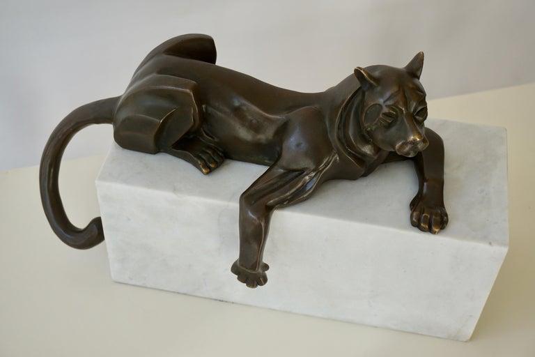 Description: Art Deco bronze sculpture of a dog. Artist/ maker: Michel Decoux, France, 1837-1924. Signature/ marks: Decoux. Bronze.  Style: Art Deco. Date: 1925-1930. Material: Bronze, patinated. Marble base. Origin: France.  Condition: Very good