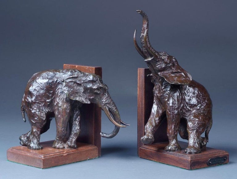 Ary Bitter (1883-1973)-A pair of patinated bronze elephant book-ends, each on wood base and one with inscribed tag, cast by Susse Frères of Paris.