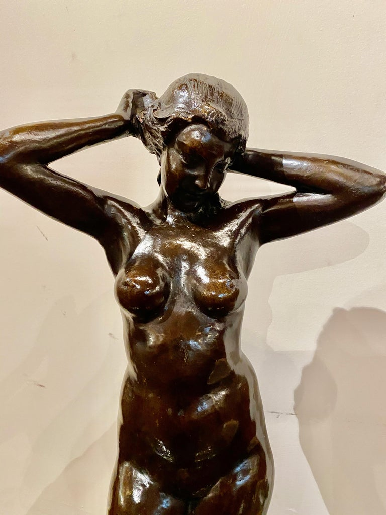Bronze dancer, circa1930. Sculpture with black patina, by MARNIX D'HAVELOOSE (1885-1973). This classically interpreted nude dancer is rendered in an elegant Art Deco style. The signature is on the base. This is an important bronze in a Classic pose,