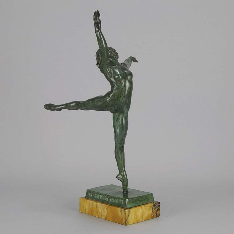 A very striking Art Deco bronze figure of the dancer Nattova in stretched ballet pose, the elegant line further emphasised by her naked body. The bronze patinaed with a deep, rich brown colour, the surface chased with fine detail and finished on a