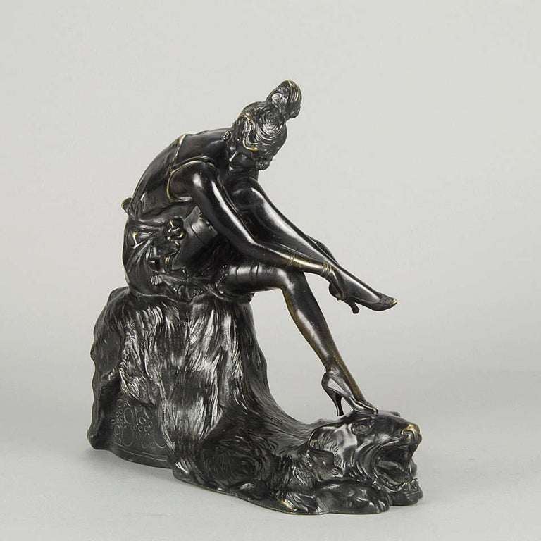 A very sensual bronze study of a an Art Deco beauty sitting on a stall as she readjusts her stocking and shoes with a bear skin laying beneath her with excellent color and very fine hand finished detail, signed Bruno Zach.