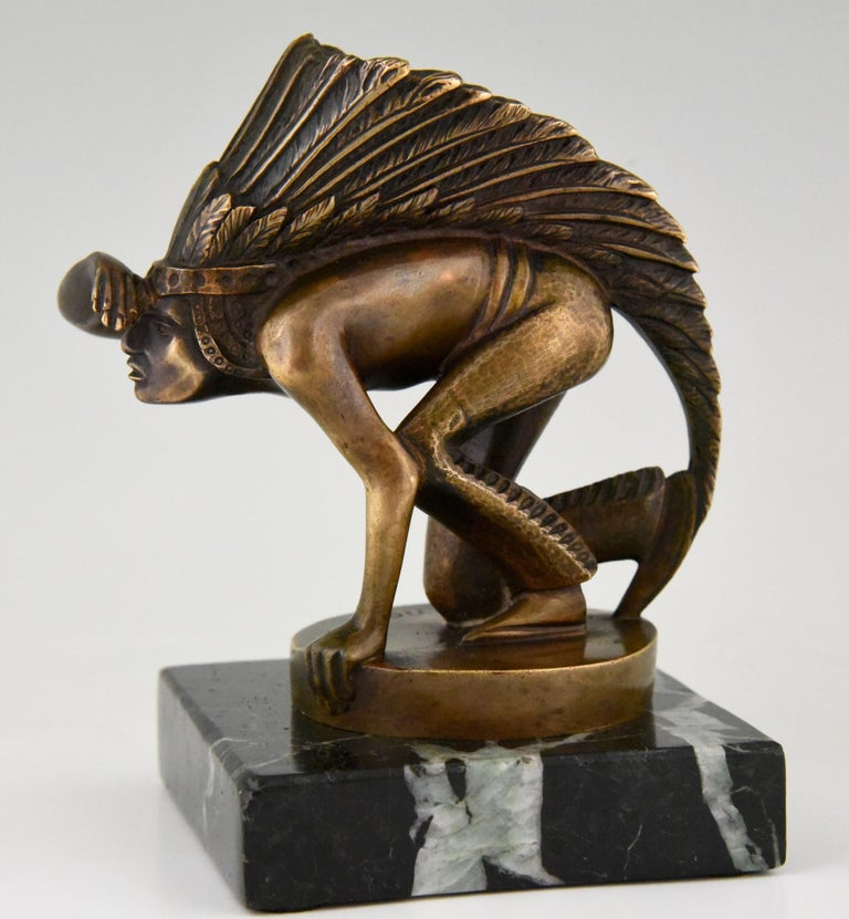 """Art Deco bronze car mascot modelled as an Indian peering signed by Guillaume Laplagne. Mounted on a marble base, circa 1920-1930. The sculpture without the base is 11 cm. or 4.3 inch high. This model is illustrated in ?""""Mascottes automobiles"""" by"""