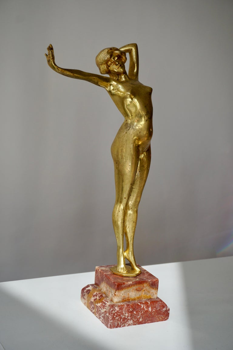Art Deco gilt bronze statue signed Reveil. This sculpture was made in the mid-1920s in the Art Nouveau and Art Deco period. It was probably made by Paul Philippe.This is authentic, vintage, in gilded bronze with a natural patina, and a beautiful