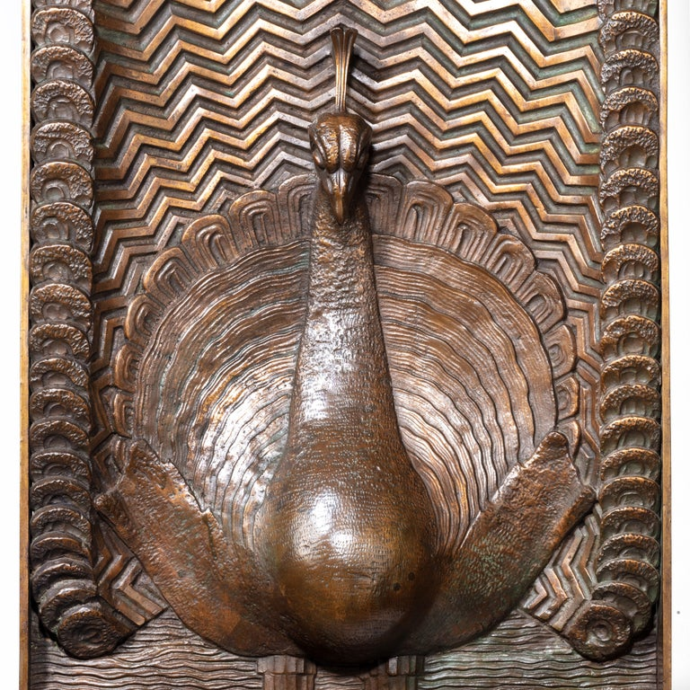 A superb Art Deco bronze panel of a peacock, (signed J Passani) the stylized tail depicted as zig-zags with the 'eyes' forming a border with triple rows at the top, probably American, circa 1920. Sold with a bespoke bronzed easel. Measures: H 43