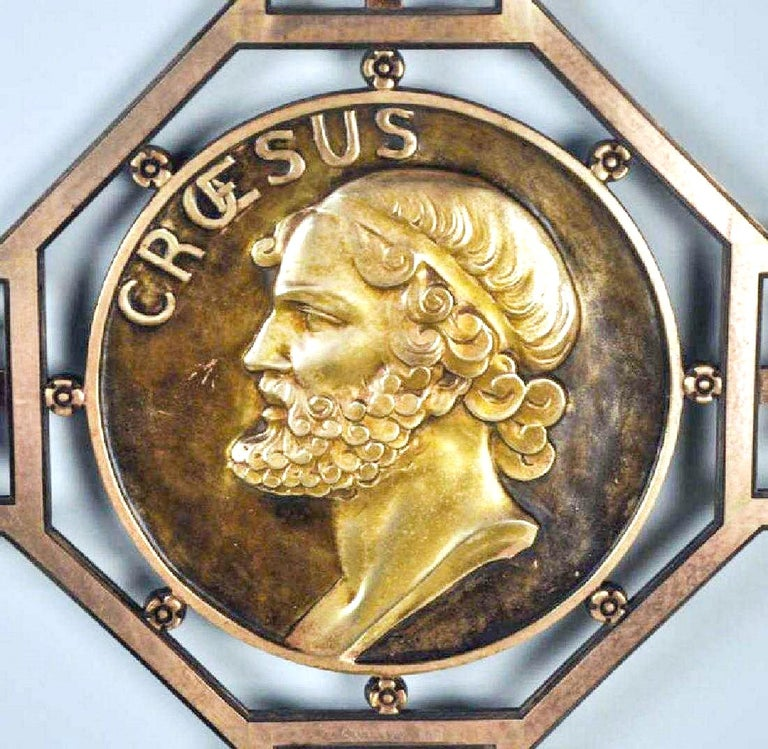 This luxury decorative and heavy bronze partition screen is designed in an artistic, creative Art Deco style. A gilded bronze medallion with the image of King Croesus is placed in the cross point of the screen. The casting is of highest quality.