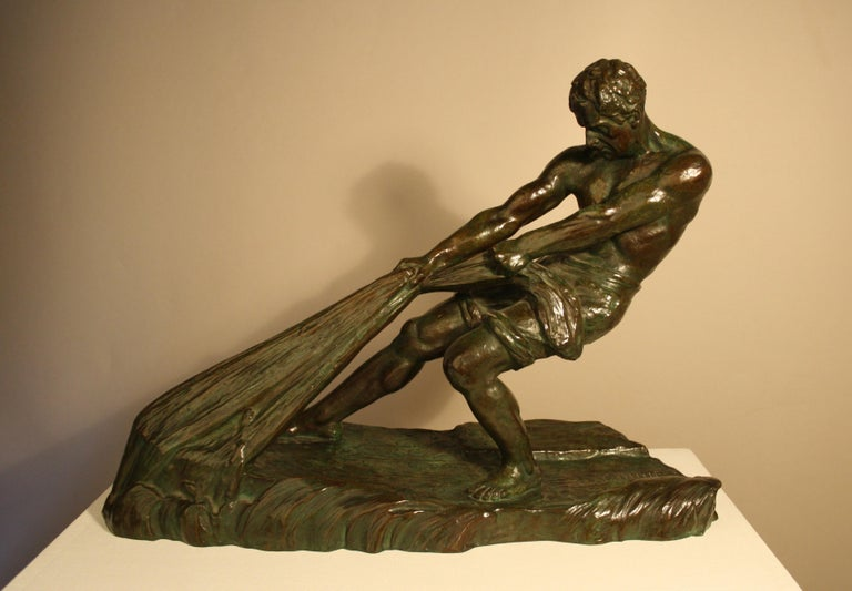 Beautiful Art Deco bronze sculpture by Alexandre Ouline depicting a fisherman. The expression of this sculpture is very successful. This is a particularly fine casting with a very nice deep dark brown and green patina in perfect condition. This