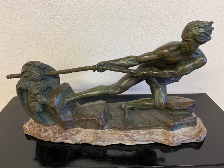Art Deco bronze with green patina of an athlete pulling a rope, symbolising