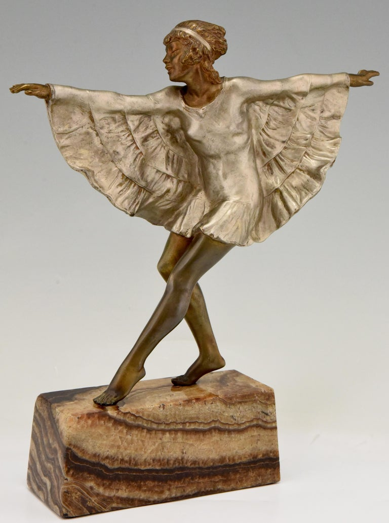 """Lovely Art Deco bronze sculpture of a dancer wearing a butterfly dress. Signed Briand, pseudonym of Marcel André Bouraine. France, circa 1925. Patinated bronze on a marble base. Literature: """"Art Deco and other figures"""" by Brian Catley. ?""""Art"""