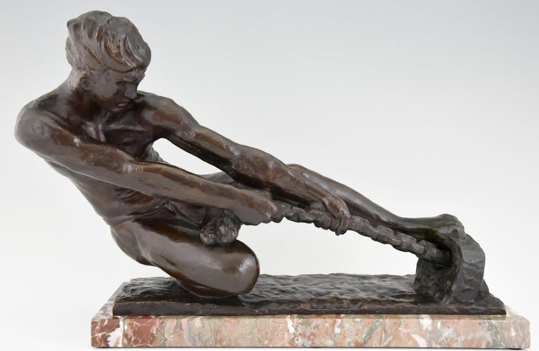 Art Deco bronze sculpture of a athletic young man pulling a rope by the French artist Alexandre Kelety. The bronze has a lovely dark brown patina and is mounted on a marble base. The sculpture is signed Kelety and has the Etling foundry mark,