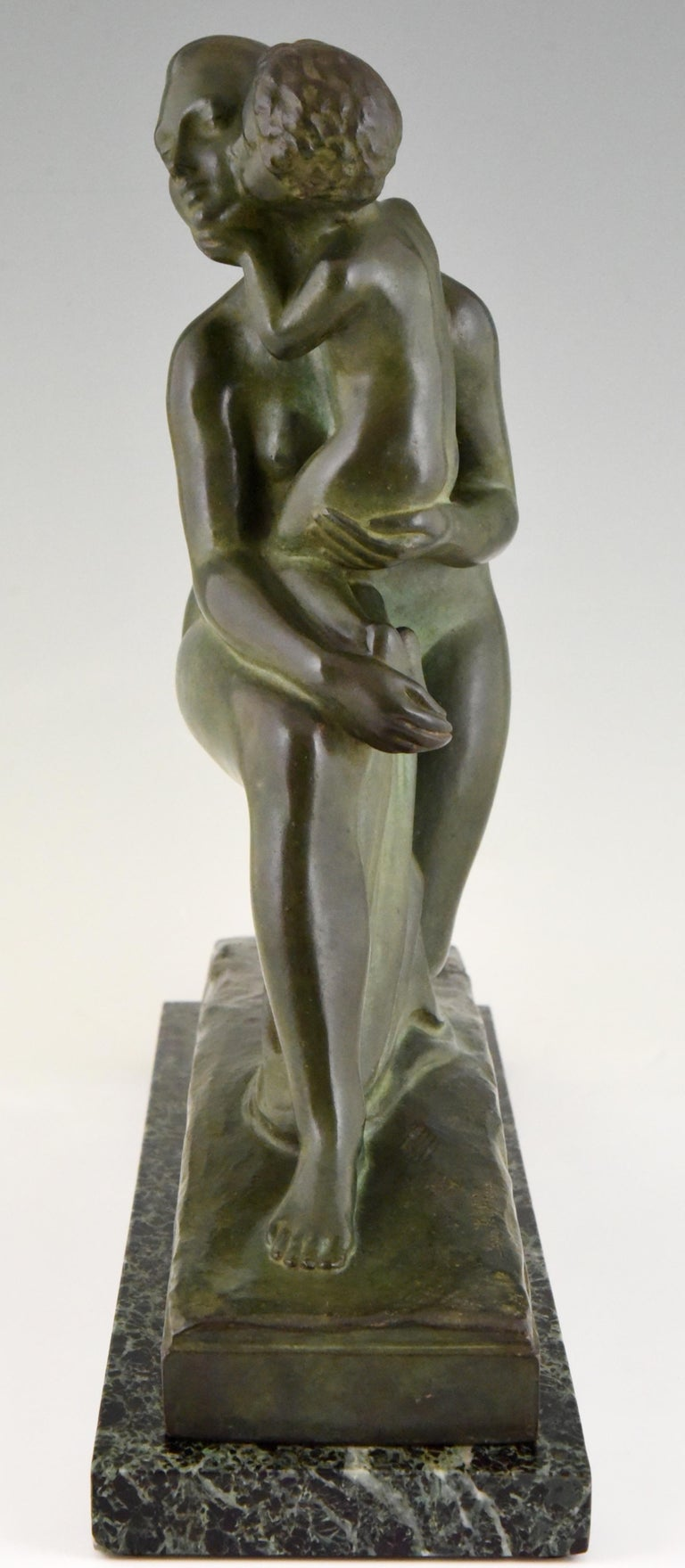 Patinated Art Deco Bronze Sculpture Mother and Child Motherhood André Huguenin Dumittan For Sale