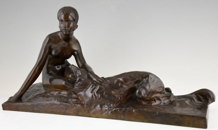 Impressive Art Deco bronze sculpture of a nude lady with her borzoi dog. The sculpture is signed Coste, marked with the Susse Freres Foundry seal. Cast in the lost wax technique Cire perdue. Beautiful rich brown patina, France, 1930.   Georges