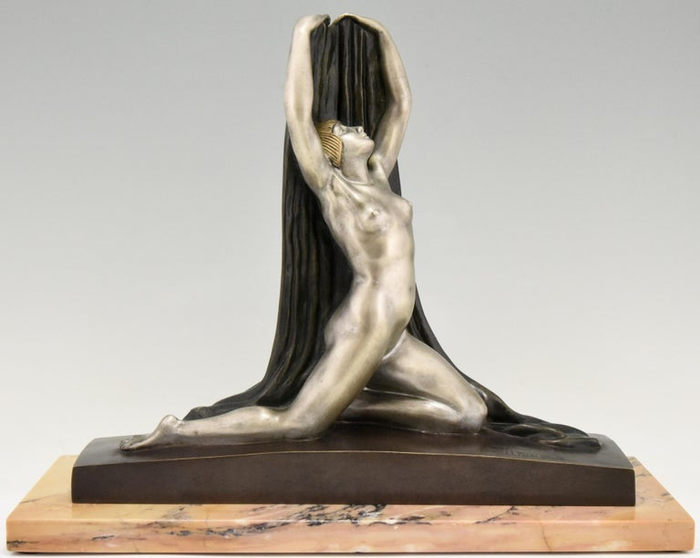 Art Deco bronze sculpture of a nude in split pose with arm outstretched holding a scarf behind her on a marble base. Beautiful multi-color patina. Signed in the bronze F. Trinque, circa 1920. Elton John had the same bronze in his